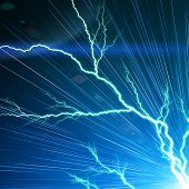 stock photo of flashing  - Electric flash of lightning on a blue background - JPG