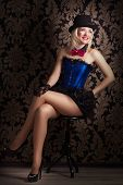 pic of cabaret  - beautiful cabaret woman posing on a chair - JPG