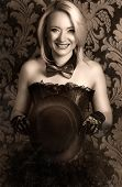 picture of cabaret  - beautiful cabaret woman posing with tophat against retro wallpapers - JPG