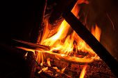picture of bonfire  - Camping Bonfire with sparks at night time - JPG