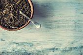 image of darjeeling  - Dry tea in wooden plate on wooden table - JPG