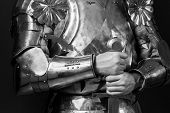 foto of longsword  - knight wearing armor and holding two - JPG