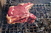 stock photo of porterhouse steak  - Heavy slice of meat named fiorentina steak ready for grill - JPG