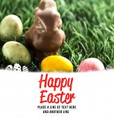 picture of easter eggs bunny  - happy easter against chocolate bunny with little easter eggs - JPG