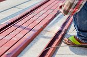 image of welding  - an man welding the iron bars together - JPG