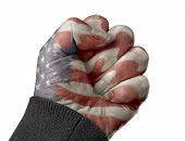 stock photo of clenched fist  - An American flag superimposed over a clenched fist - JPG