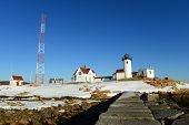 image of lighthouse  - Eastern Point Lighthouse in winter - JPG