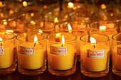 stock photo of buddhist  - Burning candles at a Buddhist templeLighting of Praying candles - JPG