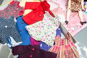 stock photo of doll  - the different clothes for a doll toy - JPG
