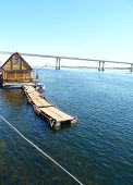 picture of pontoon boat  - Floating wooden bath on the Volga River in the city of Volgograd - JPG