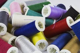 pic of rayon  - Background with colored sewing thread ready for use - JPG