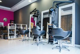 image of hair comb  - Interior of empty modern hair and beauty salon decorated in gray and fuchsia colors - JPG