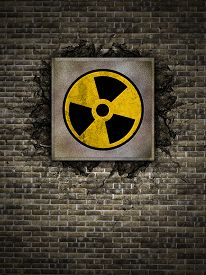 pic of polution  - symbol of nuclear danger on an old wall - JPG
