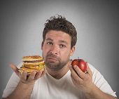 pic of junk  - Man undecided between diet and junk food - JPG