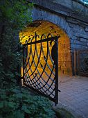 foto of gates heaven  - Open old gate in front of corridor by night - JPG