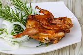 foto of quail  - Grilled quail with rosemary on the wood background - JPG