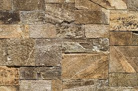 foto of gneiss  - Colorful relief cladding gneiss slabs on wall closeup - JPG