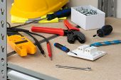 Electricians Gear And Equipment On Cork-covered Shelving poster