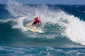 MAUI, HAWAII - DECEMBER 18, 2008:   Professional surfer Stephanie Gilmore does a huge power turn dur