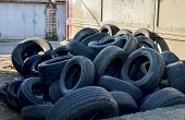 Pile Of Old Tires And Wheels For Rubber Recycling.  Tyre Dump poster