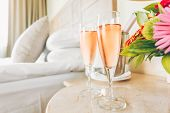 Two Glasses Of Rose Champagne In The Upscale Hotel Room. Dating, Romance, Honeymoon, Valentine, Geta poster