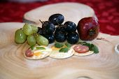 BIG CLOSE UP. Selective Focus. Appetizers on a cutting board for a Christmas. Appetizers consisting  poster