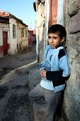 pic of child missing  - sad child standing in front of his house - JPG