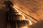 stock photo of wine cellar  - wine barrels in old wine cave - JPG