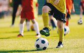 Soccer Football Training For Children. Kids Playing Soccer On Training Football Pitch. Begginer Socc poster