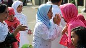 JAKARTA, INDONESIA - SEPTEMBER 20: Muslim woman greet each other and wish a happy new year and celeb