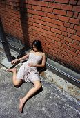 image of asian woman  - Asian girl is passed out in the gutter - JPG