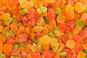 Colorful Dried Fruits Of Fruits And Berries Are Cut Into Pieces In The Shape Of Squares. Tasty And H poster