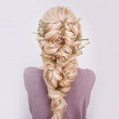 Back View Of An Elegant Trendy Hairstyle, Interlacing Curls And Decorating With Flower Petals. Beaut poster