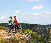 image of summer fun  - Happy mountainbike couple outdoors have fun together on a summer afternoon - JPG