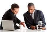 stock photo of upcoming  - Two executives of different ethnicity discuss about their upcoming project - JPG