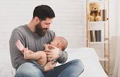 Father Holding And Soothing Crying Little Newborn Baby In His Arms. Hungry Kid Looking For Mothers B poster