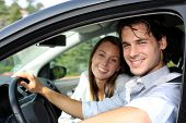 Cheerful couple driving car