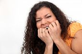 Nervous woman biting nails
