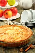 stock photo of alsatian  - Alsatian apple pie and cup of tea on a wooden table.