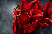 pic of evening gown  - Beautiful woman in red waving silk dress as a flame - JPG