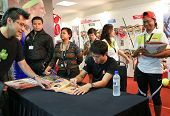 KUALA LUMPUR - SEP 22: Kei Nishikori of Japan autographs for fans in a brand promotion event of the