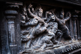 stock photo of chola  - Bas relief depicting Durga slaying demon  - JPG