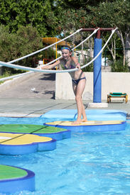 picture of tarzan  - Girl walking in tarzan pool Water Park Rhodes - JPG