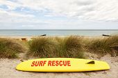 picture of coast guard  - Yellow coast guard rescue surfboard at the baltic sea beach - JPG