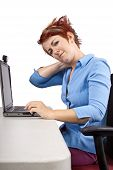 stock photo of scoliosis  - young woman demonstrating proper office desk posture - JPG