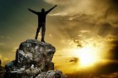 stock photo of victory  - Man on top of mountain - JPG