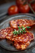 stock photo of salami  - Chorizo salami sausage on rustic background - JPG