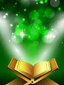 picture of islamic religious holy book  - Open Islamic religious holy book Quran Shareef on shiny abstract green background - JPG
