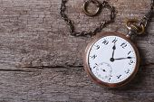 picture of boarding pass  - old gold pocket watch on a chain on an old wooden table close up - JPG