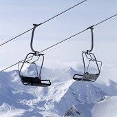 stock photo of ropeway  - Ropeway at ski resort and mountains in fog - JPG
